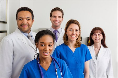 614-06897474 © Masterfile Royalty-Free Model Release: Yes Property Release: Yes Medical professionals together in hospital, portrait